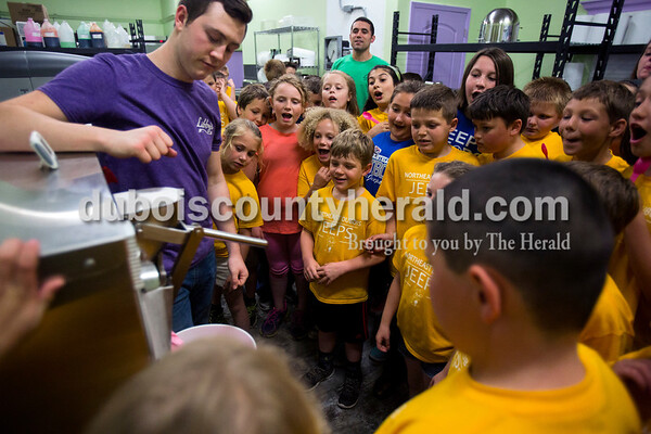 Dubois Elementary School third-graders visited Libby's on May 10 during their spring field trip. Charlie Drew of Jasper, left, and owner Matt gave them a tour of the production area and showed them the mixing and initial freezing process. Multiple school groups and organizations from around the area visit the shop throughout the year.  Alisha Jucevic/The Herald