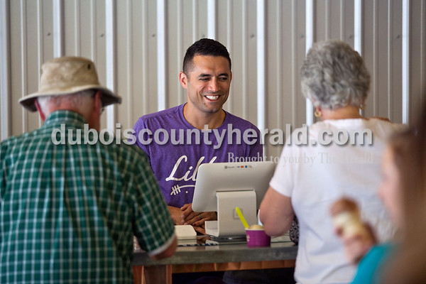 """Matt helped customers last Saturday. Matt said the goal with his clientele is not just to have a customer for the day, but to welcome them for life. He tells his staff, """"if you're going to make a mistake, make it in the customer's favor.""""  Alisha Jucevic/The Herald"""