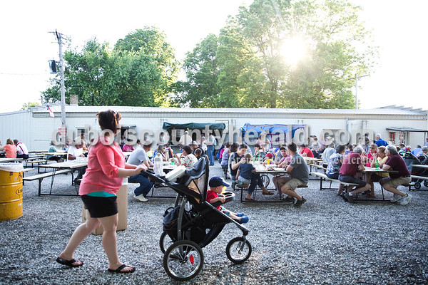 Sarah Ann Jump/The Herald Attendees sat outdoors to eat barbecue chicken, fried chicken and pork chop dinners served during Heinrichsdorf Fest in St. Henry on Friday evening.