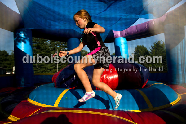 Sarah Ann Jump/The Herald Paige Memmer of Ferdinand, 7, jumped in a bounce house during Heinrichsdorf Fest in St. Henry on Friday evening.