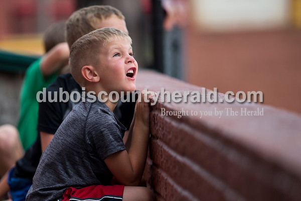 Hudson Lueken of Bretzville, 4, watched as Bombers' Logan Brown caught the ball for an out during Tuesday evening's game between the Dubois County Bombers and Paducah Chiefs at League Stadium in Huntingburg. The Bombers won 4-2. Sarah Ann Jump/The Herald