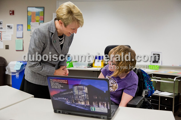 Sarah Ann Jump/The Herald Ivy Tech Community College President-Elect Sue Ellspermann talked with sophomore Sage Hawkins of Evansville as she completed an assignment in the Writing Center during her tour of the Southwest campus in Evansville on Thursday.