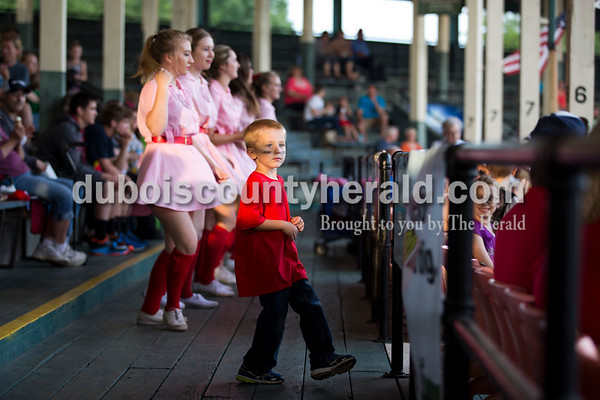"""Corde Leinenbach of Jasper, 5, danced to """"Cotton Eye Joe""""  with the Rockford Peaches during Tuesday evening's game between the Dubois County Bombers and Paducah Chiefs at League Stadium in Huntingburg. The Bombers won 4-2. Sarah Ann Jump/The Herald"""