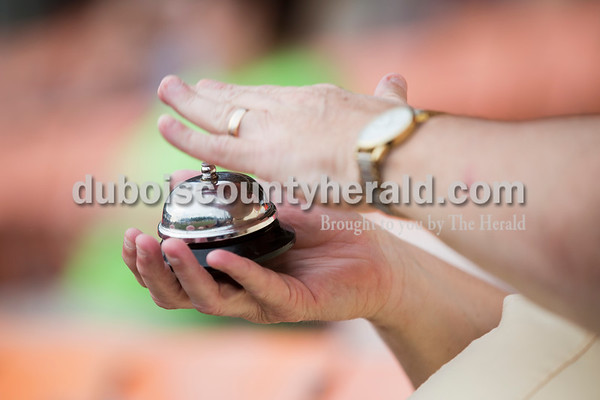 Wayne Porter of Jasper rang a bell after a play to encourage the team and crowd during Tuesday evening's game between the Dubois County Bombers and Paducah Chiefs at League Stadium in Huntingburg. The Bombers won 4-2. Sarah Ann Jump/The Herald