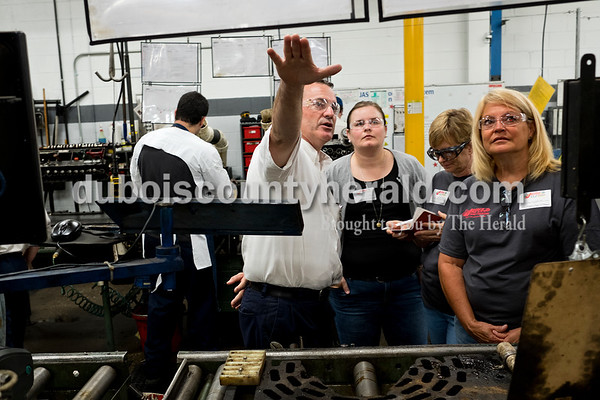 Dave Weatherwax/The Herald Jasper Engines and Transmissions group leader Brett Mehringer, left, showed one of the production lines to Cedar Crest Intermediate School teacher Hannah Sitzman, Forest Park Junior/Senior High School teacher Leslie Shobe and Northeast Dubois High School teacher Tammy Schulthies on Monday morning during the Teachers' Manufacturing Bootcamp.