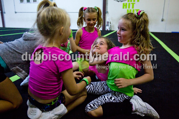 Alisha Jucevic/The Herald    Sterling Lyon of Jasper, 6, left, Jasmyn Lorey of Jasper, 7, Aubry Crawford of Jasper, 7, and Braeleigh Bex of Bedford, 7, goofed around during break at the last day of stunt and pyramid camp at Full Out Tumble and Cheer in Jasper.