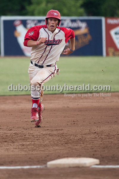 Bombers' Logan Brown ran to third and continued home for a run during Tuesday evening's game between the Dubois County Bombers and Paducah Chiefs at League Stadium in Huntingburg. The Bombers won 4-2. Sarah Ann Jump/The Herald