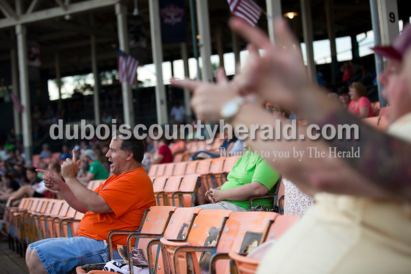 Conrad Blessinger of Huntingburg pretended to shoot guns as he cheered for the Bombers during Tuesday evening's game between the Dubois County Bombers and Paducah Chiefs at League Stadium in Huntingburg. The Bombers won 4-2. Sarah Ann Jump/The Herald