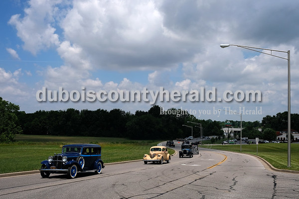 Dave Weatherwax/The Herald Members of the Willys-Overland-Knight Registry filed out of the parking lot near Los Bravos in Jasper on Monday afternoon in their antique automobiles.