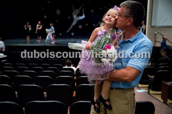 """Sarah Ann Jump/The Herald Evie Sermersheim, 3, received a kiss from her grandfather Jeff Harter, both of Jasper, after Sunday's Dance Central Academy of Performing Arts """"Got 2 Dance"""" recital at Jasper Arts Center."""