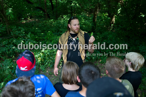 Alisha Jucevic/The Herald   Clint Jivoin of Moores Hill showed his students a selection of edible plants including plantain leaves and dandelion plants during his wilderness survival skills class at the Dave Buehler Plaza on Thursday afternoon in Jasper.