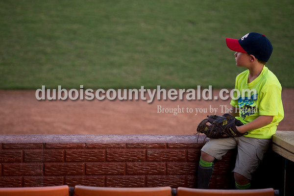 Jett Springer of Jasper, 7, watched the action during Thursday evening's game against the Owensboro Oilers at League Stadium in Huntingburg. The Bombers lost 12-3. He brings his mitt to every game incase a foul ball comes his way. He hopes to someday play for the Bombers or the Cincinnati Reds. Sarah Ann Jump/The Herald