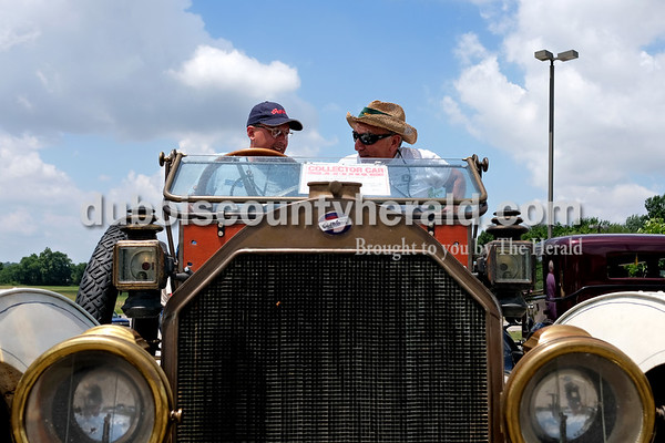 Dave Weatherwax/The Herald David Liepelt of Milan, Mich., left, and Arthur Abend of Rosemount, Minn., got situated in Liepelt's 1912 Overland Model 60 automobile as they prepared to join the Willys-Overland-Knight Registry on an outing Monday afternoon.