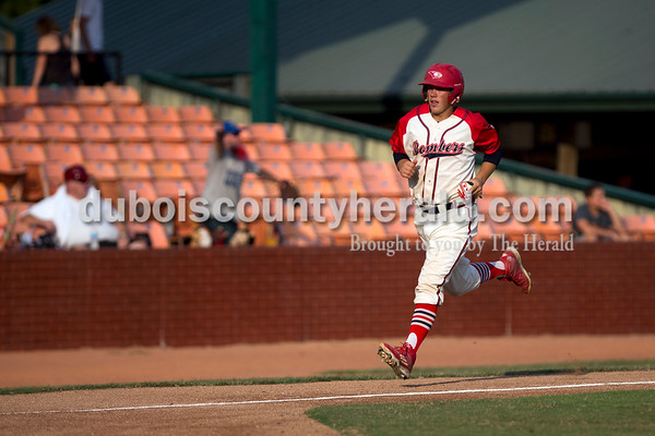 Bombers' Logan Brown ran home during Thursday evening's game against the Owensboro Oilers at League Stadium in Huntingburg. The Bombers lost 12-3. Sarah Ann Jump/The Herald