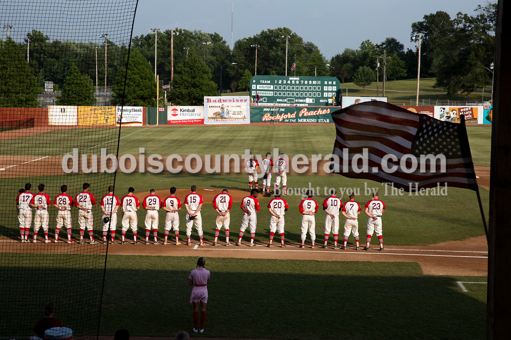 The Dubois County Bombers stood for the national anthem before Thursday evening's game against the Owensboro Oilers at League Stadium in Huntingburg. The Bombers lost 12-3. Sarah Ann Jump/The Herald