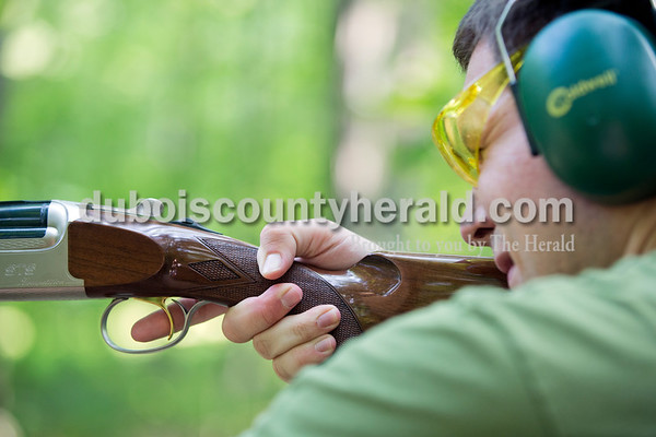 Sarah Ann Jump/The Herald Harrison Olinger of Jasper took aim during the Young Life Clay Shoot on Thursday morning at OFS Brands' Cool Springs retreat west of Huntingburg.
