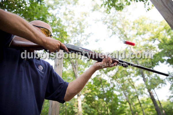 Sarah Ann Jump/The Herald Pat Fromme of Ferdinand shot at a clay pigeon during the Young Life Clay Shoot on Thursday morning at OFS Brands' Cool Springs retreat west of Huntingburg.