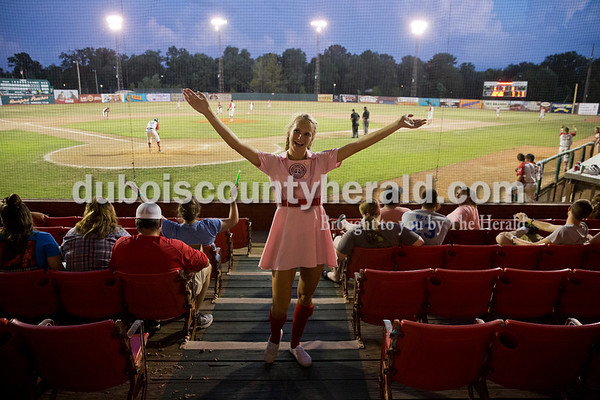 """Rockford Peach Sienna Crews of Lincoln City led the crowd in dancing to """"YMCA"""" during Thursday evening's game against the Owensboro Oilers at League Stadium in Huntingburg. The Bombers lost 12-3. Sarah Ann Jump/The Herald"""