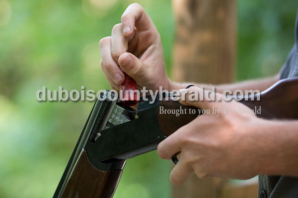 Sarah Ann Jump/The Herald Cole Anderson of Ferdinand loaded his gun during the Young Life Clay Shoot on Thursday morning at OFS Brands' Cool Springs retreat west of Huntingburg.