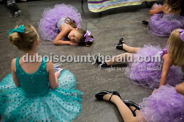 """Sarah Ann Jump/The Herald Claudia Allen of Jasper, 4, rested as other dancers watched a movie in the staging area before Sunday's Dance Central Academy of Performing Arts """"Got 2 Dance"""" recital at Jasper Arts Center. Over 215 students performed in three recitals on Saturday and Sunday. """"Getting to perform on the big stage in front of their family and friends lets the students build their self esteem and show off what they have learned,"""" said Carolyn Randolph, owner of Dance Central Academy. """"I always love seeing the dancers' and actors' faces when they walk on stage and how proud they are when they have accomplished their goals."""""""