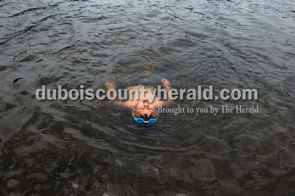 """Alisha Jucevic/The Herald   Ya'hirr Fierro Ferdinand, 6, floated on his back in the water as he played with his grandmother and cousins on Wednesday afternoon at the Ferdinand State Forest Lake. Fierro's grandmother, Gloria Villarreal of Ferdinand, said she tries to take the grandkids to the lake almost every week during the summer months. """"I like it here because it's quiet,"""" she said. """"It's good for the children to get out of the house."""""""