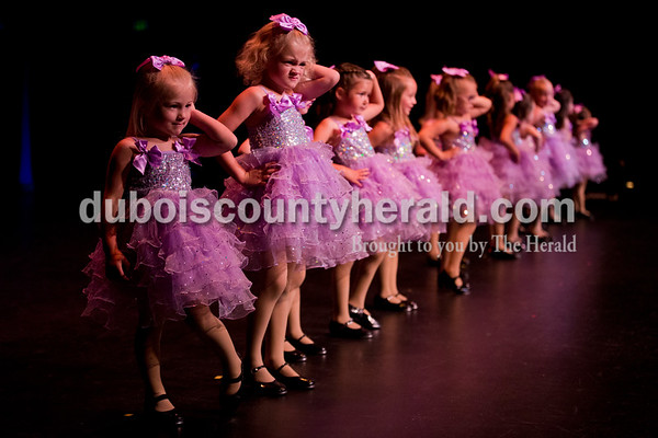 """Sarah Ann Jump/The Herald Sisters Stella, 3, and Lucy Mundy, 4, of Jasper, struck a pose at the end of their performance with their classmates during Sunday's Dance Central Academy of Performing Arts """"Got 2 Dance"""" recital at Jasper Arts Center."""