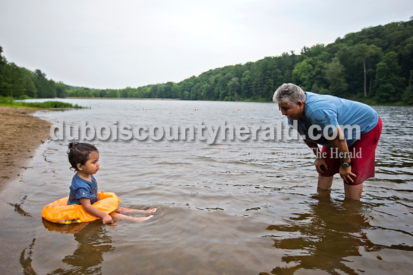 Alisha Jucevic/The Herald   Gloria Villarreal of Ferdinand talked with her granddaughter Mia Escobar, 2, as they played in the water together and waited for more family to arrive on Wednesday afternoon at the Ferdinand State Forest Lake.