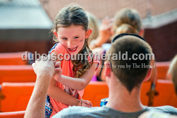 Delilah Stivers of Huntingburg, 5, goofed around with her father Tyler Stivers during Thursday evening's game against the Owensboro Oilers at League Stadium in Huntingburg. The Bombers lost 12-3. Sarah Ann Jump/The Herald