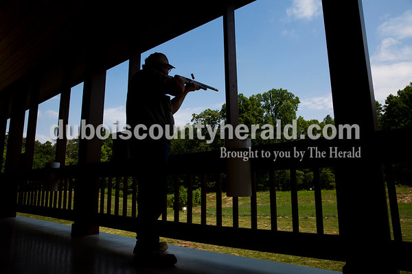 Sarah Ann Jump/The Herald Jeff Carlton of Evanston shot at a clay pigeon during the Young Life Clay Shoot on Thursday morning at OFS Brands' Cool Springs retreat west of Huntingburg.