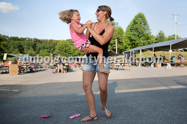 Karissa Rohleder of Ferdinand and her daughter Brynlee, 4, danced as Southern Country played during Ferdinand Heimatfest at 18th Street Park on Saturday. Sarah Ann Jump/The Herald
