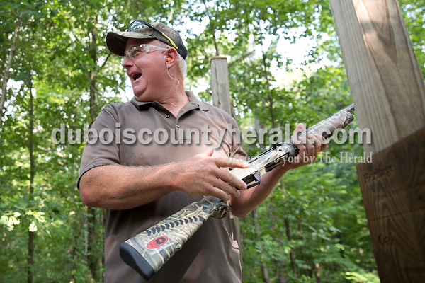 Sarah Ann Jump/The Herald Brian Rahman of Saint Meinrad laughed with his teammates after shooting during the Young Life Clay Shoot on Thursday morning at OFS Brands' Cool Springs retreat west of Huntingburg.