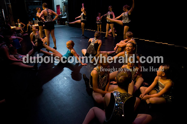 """Sarah Ann Jump/The Herald Dancers warmed up and stretched on stage before the curtains opened for Sunday's Dance Central Academy of Performing Arts """"Got 2 Dance"""" recital at Jasper Arts Center."""