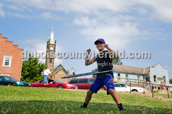 Alisha Jucevic/The Herald   Children gathered on the Jasper Public Library front lawn for an outdoor fun day on Monday, the official first day of summer. During the first activity, Clay Letterman of Jasper, 9, twirled a hula hooped for as long as he could before it slipped down to his feet. The children also participated in a bean bag toss, parachute games, a water balloon toss and colored popsicles.