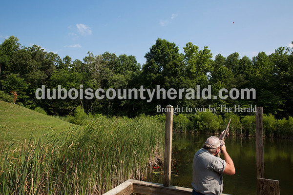 Sarah Ann Jump/The Herald Jeff Carlton of Evanston took aim at a clay pigeon during the Young Life Clay Shoot on Thursday morning at OFS Brands' Cool Springs retreat west of Huntingburg.
