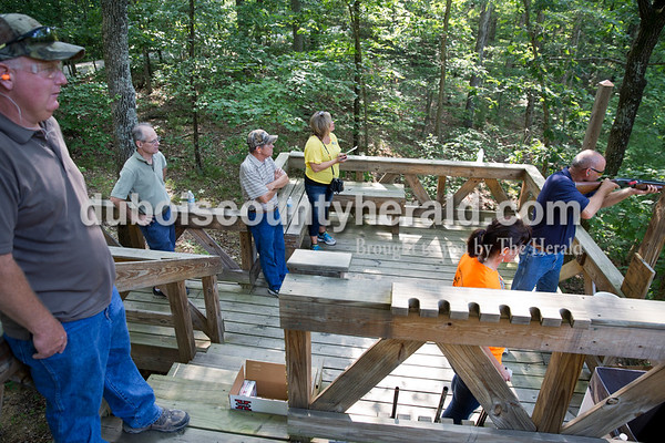 Sarah Ann Jump/The Herald Brian Rahman of Saint Meinrad, left, John Beckman, Tony Krapf, Jill Nordhoff, Lori Sunderman, all of Jasper, watched as Pat Fromme of Ferdinand shot during the Young Life Clay Shoot on Thursday morning at OFS Brands' Cool Springs retreat west of Huntingburg.