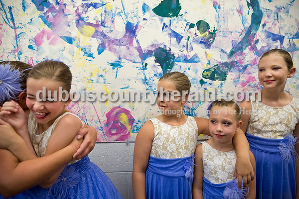 """Sarah Ann Jump/The Herald Harper Knies, 10, and Chloe Beck, 10, both of Jasper, left, hugged as they did a """"partner check"""" as Maya Knies of Jasper, 10, Kennedy Huff of Loogootee, 9, and Brenna Hildenbrand of Jasper, 12, looked on while the dancers lined up in order with their dance partners before going on stage during Sunday's Dance Central Academy of Performing Arts """"Got 2 Dance"""" recital at Jasper Arts Center."""