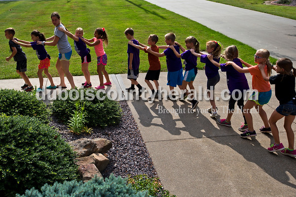 Alisha Jucevic/The Herald   Campers and volunteers formed a train as they walked to the next activity station at Saint Mary's Parish in Ireland on Tuesday morning during the second day of vacation bible school.