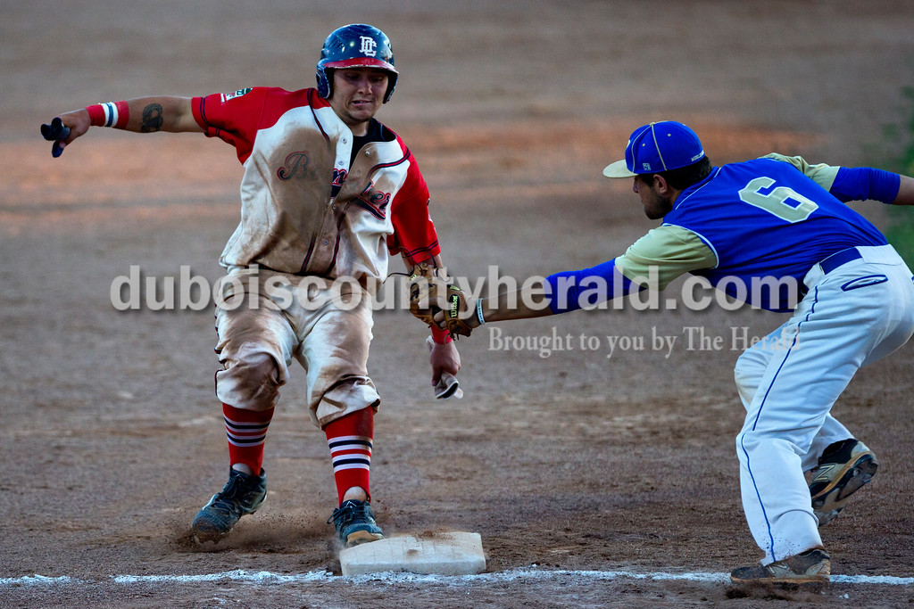 Alisha Jucevic/The Herald <br /> <br /> Bombers' Trey Fulton ran safely into third as Muhlenberg County's Mark Treadway tried to tag him out during Tuesday night's game at League Stadium in Huntingburg. The Bombers won 10-2.