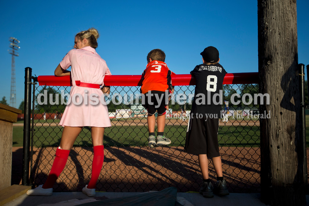 Alisha Jucevic/The Herald <br /> <br /> Bombers Peach Sienna Crews of Lincoln City, left, Isaac Eastridge of Jericho, 7, and Spencer Enlow of Eckerty, 10, waited for the end of an inning so they could play musical chairs during Tuesday night's game against the Muhlenberg County Stallions at League Stadium in Huntingburg.