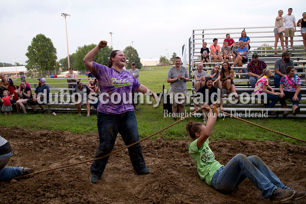 Sarah Shaw/The Herald  Sara Obermeier of Huntingburg celebrated after her team won the adult tug-of-war competition at the Dubois County 4-H Fairgrounds in Bretzville on Thursday evening. This was the first year for the adult competition.