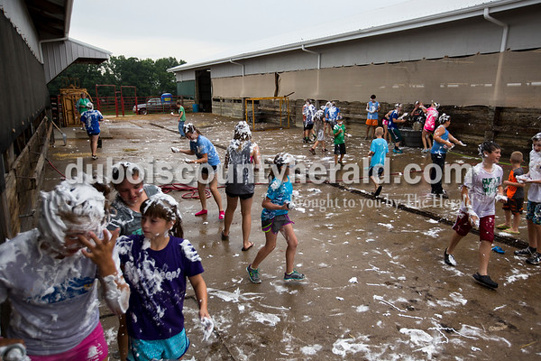 The pathway between the swine barn and the beef barn buzzed with screams, splashing water and shaving cream as the annual shaving cream fight began on Thursday morning at the Dubois County 4-H Fairgrounds in Bretzville.   Alisha Jucevic/The Herald
