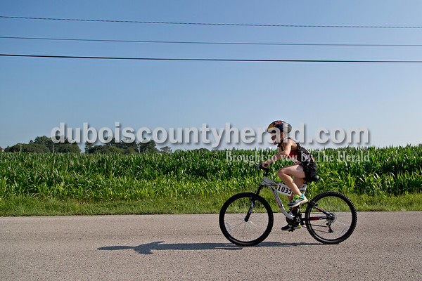 Sarah Shaw/The Herald  Gabe Land of Newburgh, 11, biked down 1st Street during the Dubois County Youth Triathlon and Duathlon on Saturday at Huntingburg City Park.