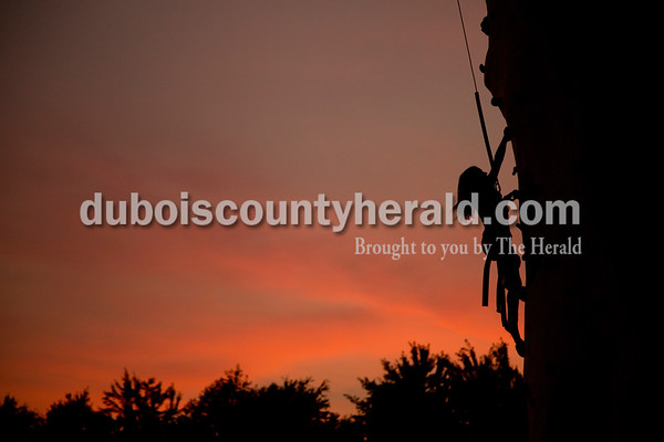 Sarah Shaw/The Herald  Lily Harpe of Alexandria, 9, climbed the tower at the Dubois County 4-H Fairgrounds in Bretzville on Thursday evening.