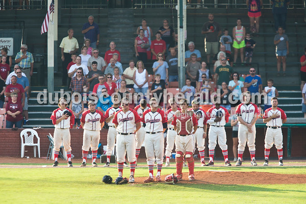 Sarah Ann Jump/The Herald The Dubois County Bombers and fans stood for the national anthem before Wednesday evening's Dubois County Bombers game against the Muhlenberg County Stallions at League Stadium in Huntingburg. The Bombers won 5-1.