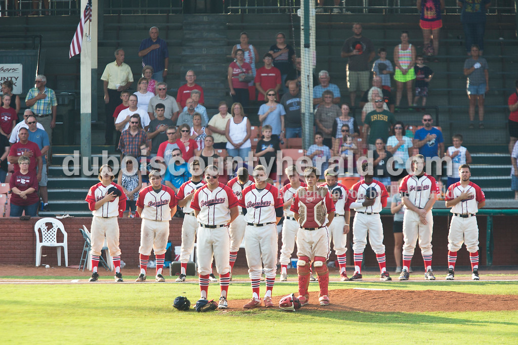 Sarah Ann Jump/The Herald<br /> The Dubois County Bombers and fans stood for the national anthem before Wednesday evening's Dubois County Bombers game against the Muhlenberg County Stallions at League Stadium in Huntingburg. The Bombers won 5-1.