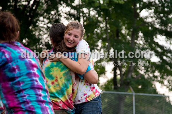 Sarah Shaw/The Herald  Melanie Roberts of Hillham, 17, hugged Alexa Hopf of Huntingburg, 16, after their side won the battle of the queens during the tug-of-war competition at the Dubois County 4-H Fairgrounds in Bretzville on Thursday evening.