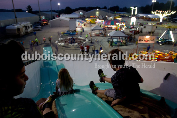 Sarah Shaw/The Herald  Fairgoers slid down the Wild Thing slide at the Dubois County 4-H Fairgrounds in Bretzville on Thursday evening.