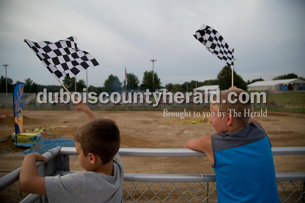 Sarah Shaw/The Herald  Kale Talber of Haysville, 8, and Dillen Robling of Jasper, 8, cheered during the Mini Monster Truck show at the Dubois County 4-H Fairgrounds in Bretzville on Tuesday. Lil Monster Trucks, a professional mini monster truck team out of St. Louis, visited the Dubois County 4-H Fair for the first time this year. Seven drivers, ages 6 to 15 raced and performed freestyle tricks.
