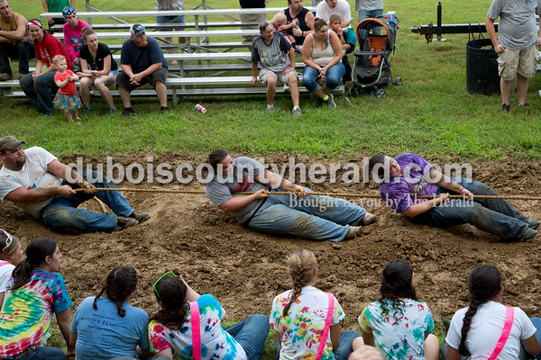 Sarah Shaw/The Herald  4-H Fair Queen contestants watched as Adam Wagner, Susan Wagner, both of St. Henry, and Sara Obermeier of Huntingburg competed in the adult tug-of-war competition at the Dubois County 4-H Fairgrounds in Bretzville on Thursday evening. This was the first year for the adult competition.
