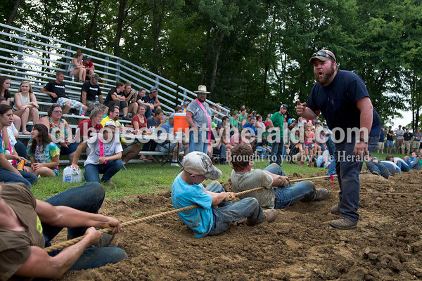 Sarah Shaw/The Herald  James Wagner of St. Henry, yelled at his team to pull during the tug-of-war competition at the Dubois County 4-H Fairgrounds in Bretzville on Thursday evening.
